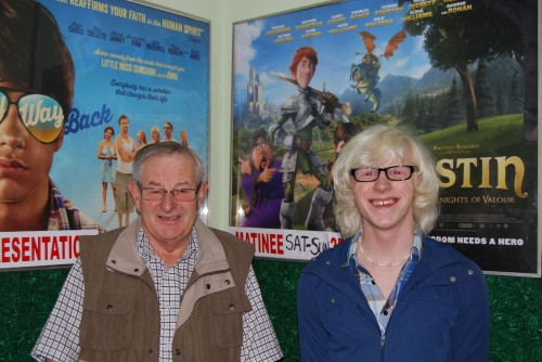 Brian and Tom in front of film posters